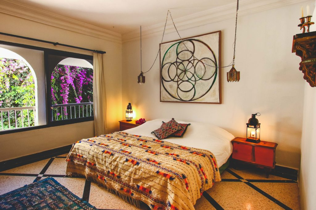 A comfortable looking bohemian style bedroom