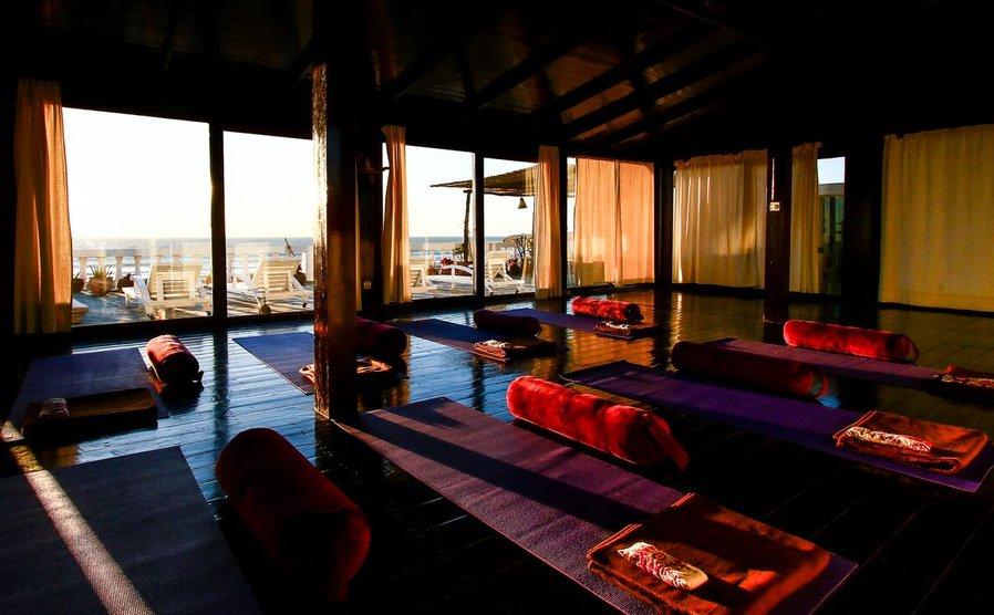 Villa Mandala's yoga shala with big windows and mats laid out
